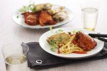 Chicken breast with tagliatelle pasta — Stock Photo
