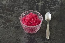 Closeup view of cranberry and lime granita in a glass bowl — Stock Photo