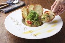 Salmon tartare with avocado — Stock Photo