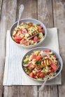 Chifferi pasta salad with watermelon and halloumi — Stock Photo
