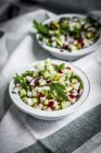Vegetable salads in bowls on towel — Stock Photo