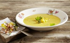 Lusatian potato soup with chasseur sausage on white plate  over wooden surface — Stock Photo