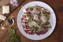 Beef Carpaccio on plate — Stock Photo