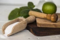 Wooden scoop with sugar — Stock Photo