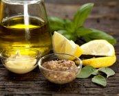 Closeup view of oil with Dijon mustard, wholegrain mustard, lemon, basil and sage — Stock Photo