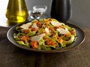 Tagliatelle verdi pasta with calabrese pesto — Stock Photo