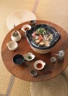 Elevated view of dining table with seafood soup — Stock Photo