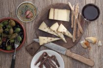 Cheese on wooden desk — Stock Photo