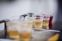 Juice in plastic cups — Stock Photo
