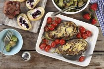Aubergines with potato salad and chocolate cake — Stock Photo
