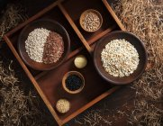 Grains in wooden bowls — Stock Photo