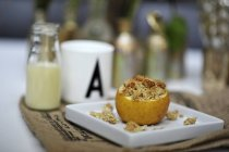 Stuffed baked apple with crumbles — Stock Photo