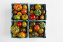 Tomatoes in cardboard punnets — Stock Photo