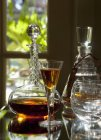 Closeup view of Armagnac in a glass and a decanters — Stock Photo