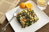 Chickpea salad with kale and tangerines — Stock Photo