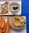 Various dips with carrot — Stock Photo