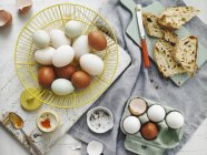 Brown and white eggs in basket — Stock Photo