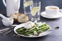 Poached asparagus with cheese — Stock Photo
