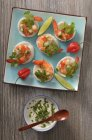 Top view of canapes with prawns, herbs and chive dip — Stock Photo