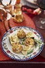 Stuffed gratinated courgettes and mushrooms on plate — Stock Photo