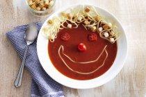 Funny tomato soup — Stock Photo