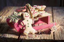 Gingerbread biscuits on sleigh — Stock Photo