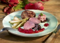 Venison fillet with pears — Stock Photo
