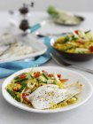 Grilled lemon sole with golden couscous — Stock Photo