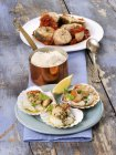 Closeup view of scallops and conger eel with white Polenta — Stock Photo