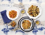 Fish and seafood dishes with pasta — Stock Photo