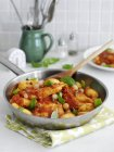 Fried chicken with potatoes and basil — Stock Photo