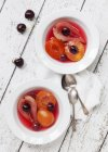 Closeup top view of poached fruit with vanilla — Stock Photo