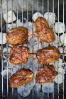 Lamb point steaks on barbecue — Stock Photo