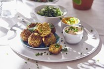 Portion of falafel serving with dip — Stock Photo