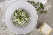 Herb risotto with cheese — Stock Photo