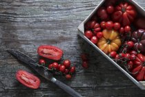 Arious tomatoes in box — Stock Photo