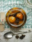 Closeup top view of preserved Clementines in glass jar — Stock Photo