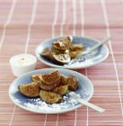 Closeup view of poached figs with saffron whipped cream — Stock Photo