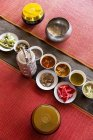 Elevated view of different Thai dishes in a row on red carpets — Stock Photo