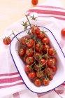 Cherry tomatoes in enamel dish — Stock Photo