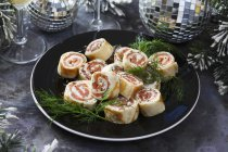 Smoked salmon rolls — Stock Photo
