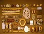 Selection of breads over table — Stock Photo