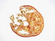 Rebanada fina de tomate - foto de stock
