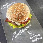 Beefburger with bacon and lettuce — Stock Photo
