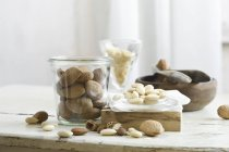 Almonds in and next to glass jar — Stock Photo