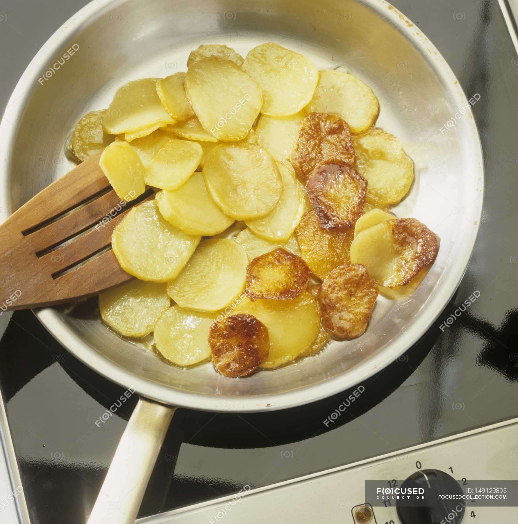 Slices Of Fried Potatoes Background Cookery Stock Photo 149129895