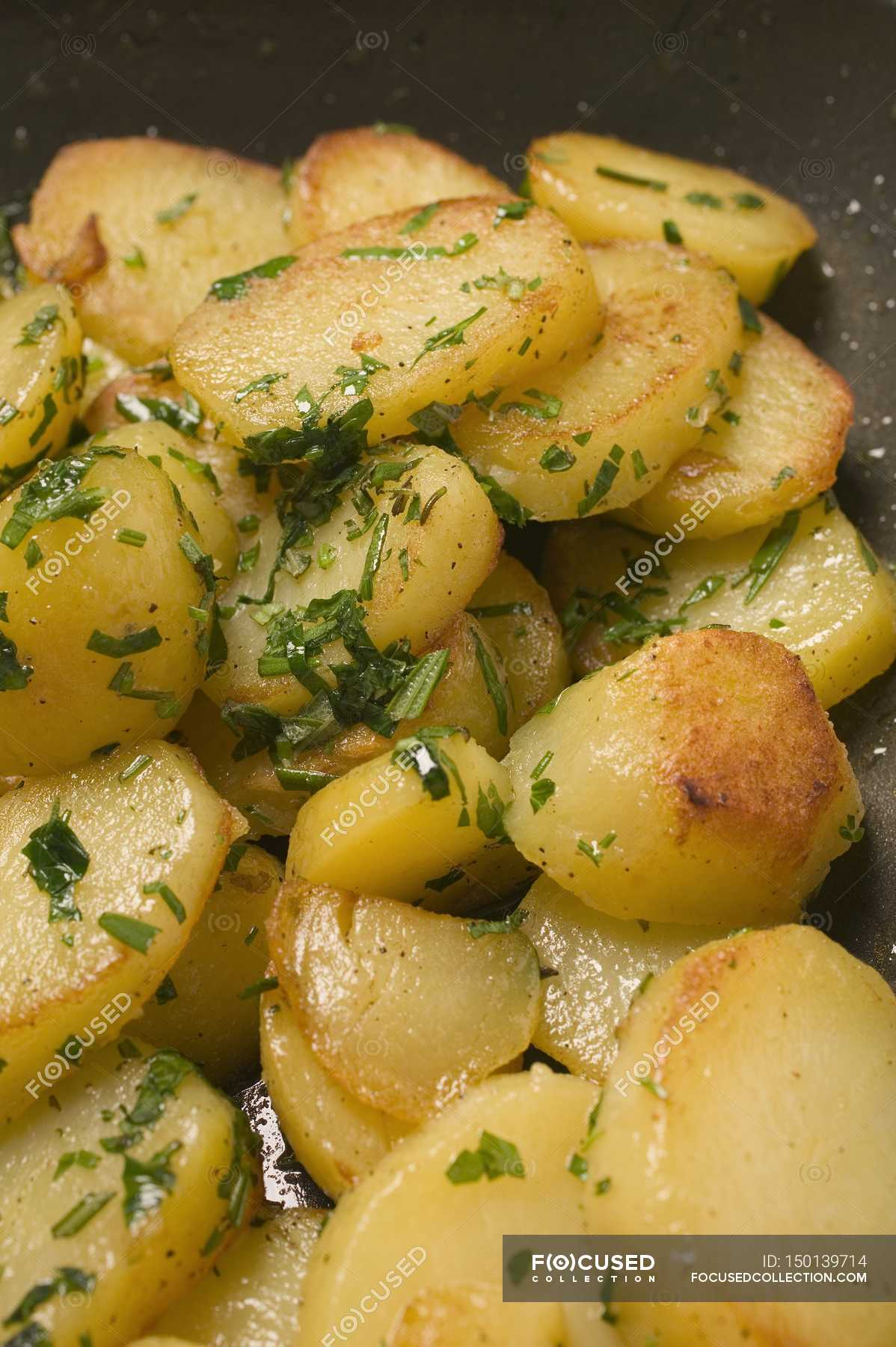 Close Up Of Sliced Fried Potatoes With Herbs Delicious Nutrition Stock Photo 150139714