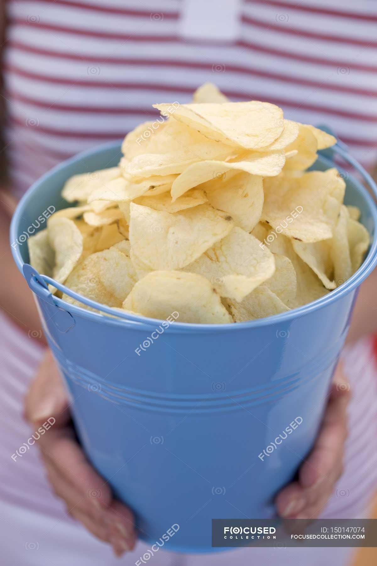 Woman Holding Potato Crisps In Blue Bucket Vegetable Delicious Stock Photo 150147074