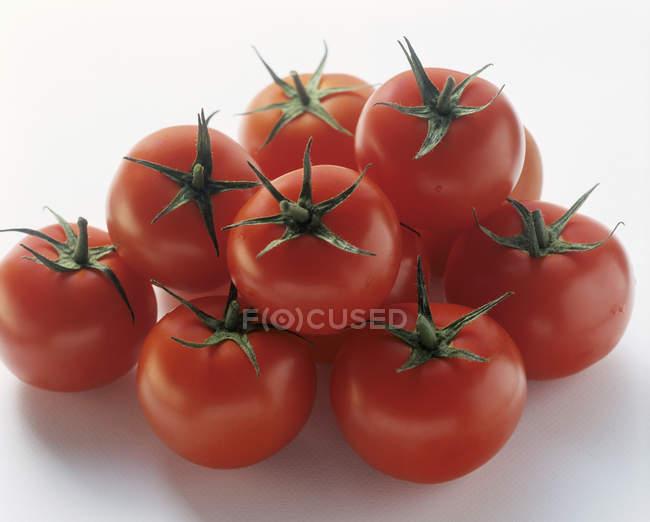 Одинадцять червоні помідори — стокове фото