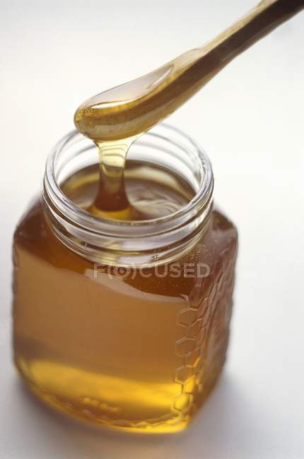 Honey Dripping from Server — Stock Photo